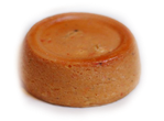 Steamed bean pudding made from a mixture of washed and peeled black-eyed beans, onions and fresh ground peppers.