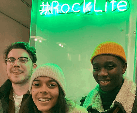 Customers standing under #Rocklife sign
